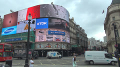 Piccadilly Circus neon sign traffic street car pass tourist people travel London Stock Footage