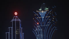 HD video of the Grand Lisboa casino hotel in Macau at night Stock Footage