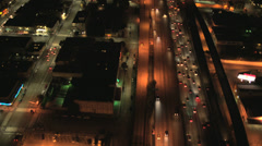 Aerial illuminated night view suburban road traffic, USA - stock footage