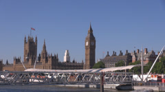 Big Ben Clock Tower London Westminster Parliament House bridge footbridge people Stock Footage