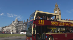 Double-decker red bus traffic car street black taxi Big Ben Clock Tower London  Stock Footage