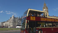 Stock Video Footage of Double-decker red bus traffic car street black taxi Big Ben Clock Tower London