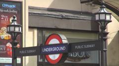 Metro sign London UK underground train station information street outdoor travel Stock Footage