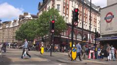 London street cityscape pedestrian people cross traffic light sunny day black  Stock Footage