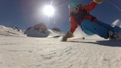 Stock Video Footage of skiers skiing over camera