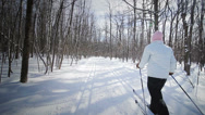 Stock Video Footage of Woman Cross-Country Skiing Alone in Nature