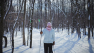 Stock Video Footage of Woman Cross-Country Skiing Alone (handheld camera angle)