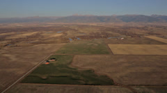 Aerial shot of Teton Valley in Idaho with the Teton mountains in background Stock Footage