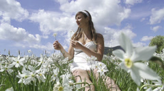 SLOW MOTION: Young woman gathering flowers Stock Footage
