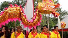 A group of Asian people dance dragon in folk festivals Stock Footage