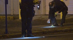 Police Marking Crime Scene After A Stabbing Overnight At A Bar 1 - stock footage