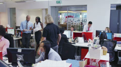 Attractive diverse business group working together in a busy modern office - stock footage