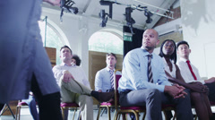 Cheerful diverse business group at business presentation or training seminar - stock footage