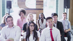 Cheerful diverse business group at business presentation or training seminar Stock Footage