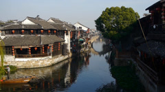 Traditional Chinese houses in XiTang Water Town,fishman boating,shanghai,China. Stock Footage