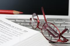 laptop book and glases - stock photo
