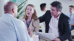 Couple in a meeting with their bank manager or financial advisor Stock Footage
