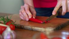 Slicing hot pepper on chopping board, slow motion HD Stock Footage