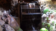 Functional water mill in traditional house, wood wheel, water flowing, indoors - stock footage