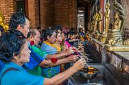Stock Photo of people lighting incense wat yai chaimongkol ayutthaya bangkok thailand