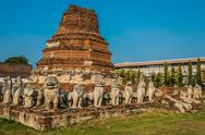 Stock Photo of chedi surrounded lion statues wat thammikarat temple ayutthaya bangkok thaila