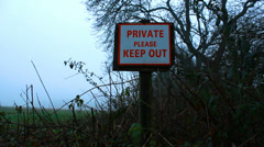 Dolly out KEEP OUT sign (misty) Stock Footage