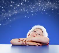 little boy looking up to starry night sky - stock photo