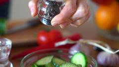 Sprinkle pepper on cucumber salad, super slow motion, shot at 240fps HD Stock Footage
