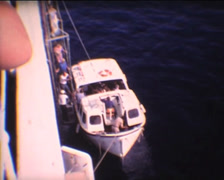 SUPER8 passengers leaving cruise by taxi boat Stock Footage