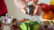 Stock Video Footage of Sprinkle pepper on cucumber salad in bowl HD