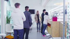 Queue of people waiting in line to be served - stock footage