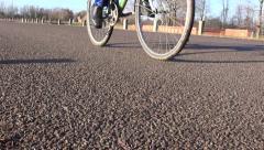 Bicycle wheels on asphalt road in motion Stock Footage