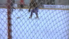 Ice Hockey - Male Training - 17 - Few Players Make Shots - Over Goal Net Stock Footage