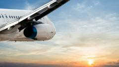 Close up of a jet plane cruising in a sunset sky Stock Footage