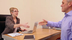 Doctor and patient consultation in Doctors surgery - stock footage
