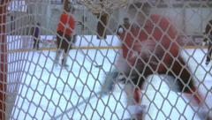 Ice Hockey - Male Training - 13 - Few Players Driving & Passing - Over Goal Net Stock Footage