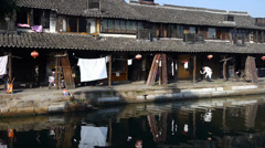 Chinese ancient houses reflection on water,XiTang Water Town resident life. Stock Footage