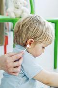Stock Photo of ear hygiene child