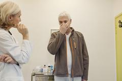 Ear nose &throat, elderly person Stock Photos