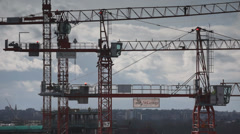 Tower Crane Operative climbs out on jib Stock Footage
