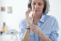 Painful wrist in an elderly p. Stock Photos