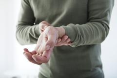 Painful wrist in a man Stock Photos