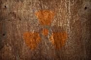 Stock Photo of nuclear radiation sign on rusty metal texture