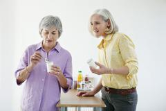 Elderly person, dairy product Stock Photos