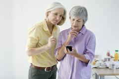 elderly person on the phone - stock photo