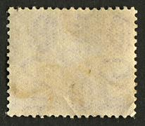 Stock Photo of the reverse side of a postage stamp.