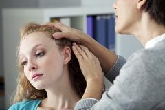 Stock Photo of dermatology consultation woman