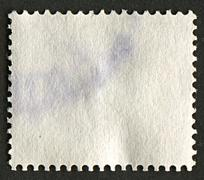 The reverse side of a postage stamp. Stock Photos