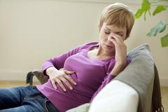 Abdominal pain in a woman Stock Photos