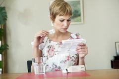 woman taking medication - stock photo